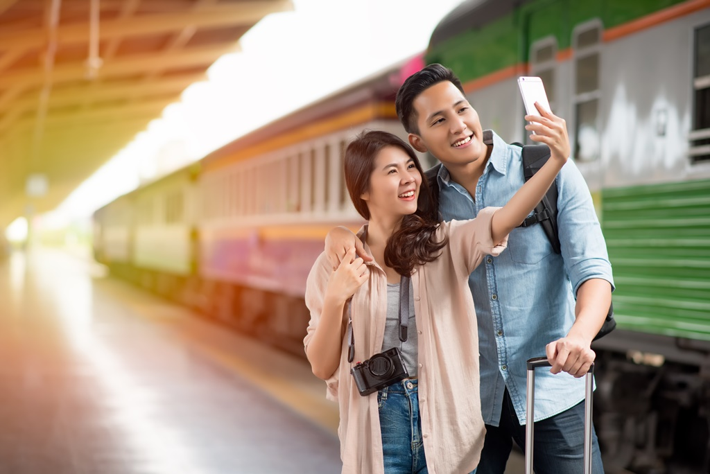 young couple at the train station